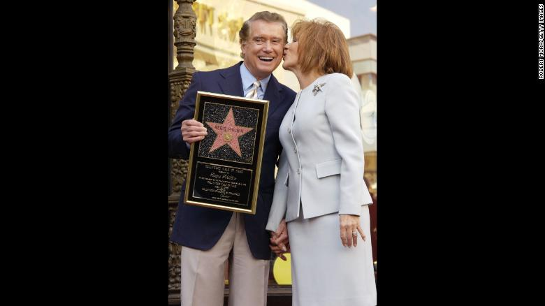 Regis Philbin and his wife Joy pose for a photograph after he received a star on the Hollywood Walk of Fame on April 10, 2003, in Hollywood, California.