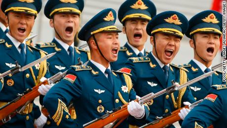 BEIJING, CHINA - NOVEMBER 9:  Military troops march during a welcoming ceremony for U.S. President Donald Trump on November 9, 2017 in Beijing, China. Trump is on a 10-day trip to Asia.  (Photo by Thomas Peter-Pool/Getty Images)