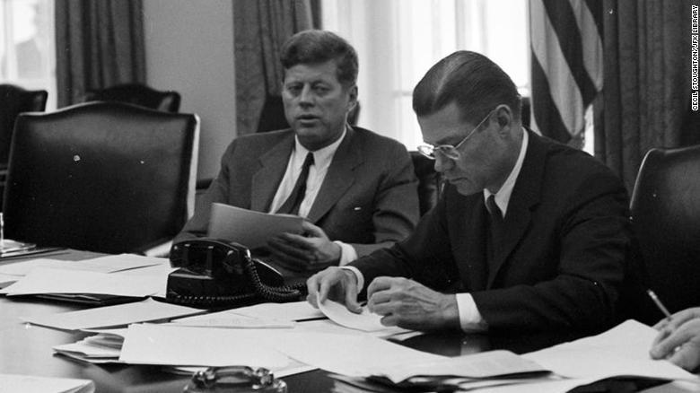 President Kennedy and Defense Secretary Robert McNamara confer on the crisis in October 1962.