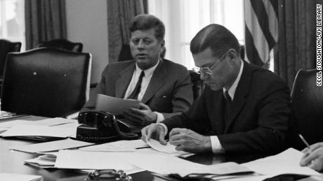 President Kennedy and Defense Secretary Robert McNamara confer on the crisis in October 1962.