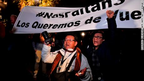 Relatives and colleagues of two journalists and a driver who were abducted on the border with Colombia, demonstrate during a vigil at the Independence square in Quito on March 27, 2018.  Two journalists for an Ecuadoran newspaper and their driver were abducted in a border zone where former Colombian FARC rebels remain active, officials said Tuesday. / AFP PHOTO / RODRIGO BUENDIA        (Photo credit should read RODRIGO BUENDIA/AFP/Getty Images)