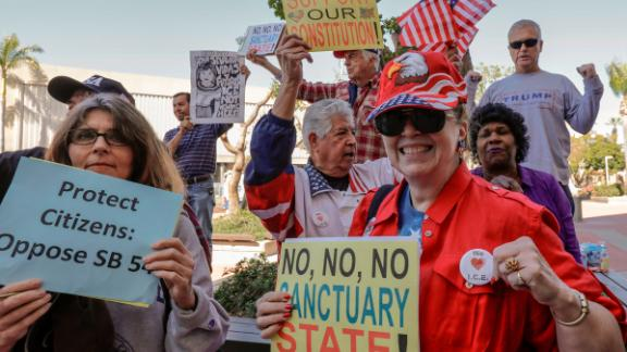 People opposing SB 54 celebrate Tuesday in Santa Ana, California.