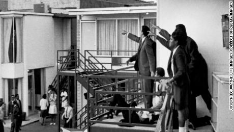 Ralph Abernathy, Jesse Jackson and others point in the direction of gunshots that killed Martin Luther King Jr.