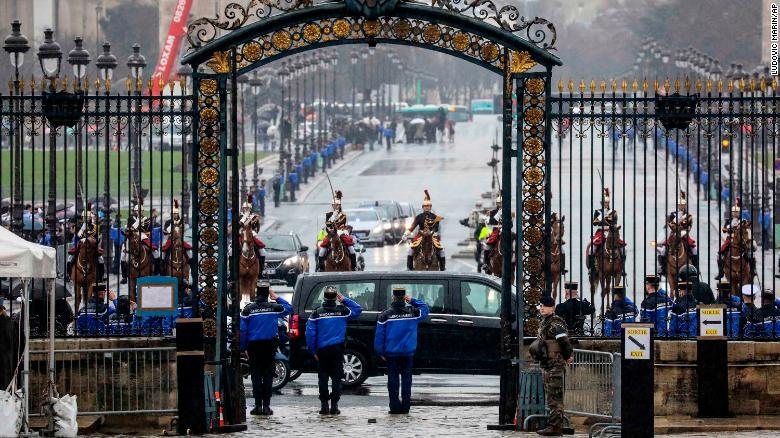 A convoy of French Republican Guards escort the hearse carrying Beltrame's coffin.