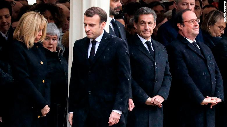 French President Emmanuel Macron (center) with wife Brigitte (left) and former presidents  Nicloas Sarkozy and François Hollande attend the ceremony for Beltrame.