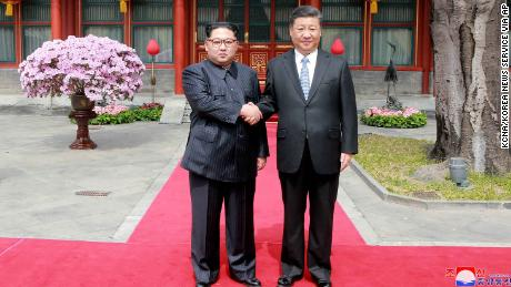 "In this March 27, 2018, photo, North Korean leader Kim Jong Un, left, shakes hands with Chinese counterpart Xi Jinping at Diaoyutai State Guesthouse in Beijing, China. North Korea's leader Kim Jong Un and his Chinese counterpart Xi Jinping sought to portray strong ties between the long-time allies despite a recent chill as both countries on Wednesday, March 28, 2018, confirmed Kim's secret trip to Beijing this week. The content of this image is as provided and cannot be independently verified. Korean language watermark on image as provided by source reads: ""KCNA"" which is the abbreviation for Korean Central News Agency.  (Korean Central News Agency/Korea News Service via AP, File)"