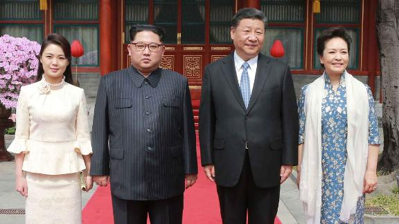 In this March 27, 2018, photo, North Korean leader Kim Jong Un, center left, and his wife Ri Sol Ju, left, Chinese counterpart Xi Jinping, center right, and his wife Peng Liyuan pose for a photo at Diaoyutai State Guesthouse in Beijing. North Korea