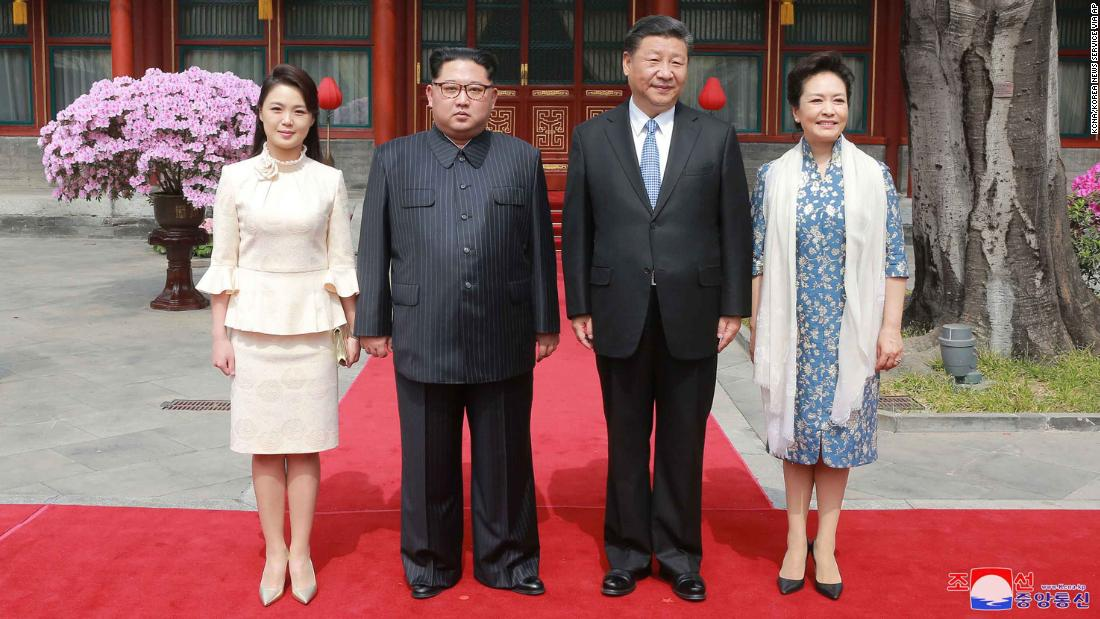 North Korean leader Kim Jong Un, his wife Ri Sol Ju, Xi Jinping and his wife Peng Liyuan pose for a photo at Diaoyutai State Guesthouse in Beijing.