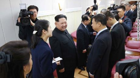 "In this March 27, 2018, photo, North Korean leader Kim Jong Un, center left, talks with Song Tao, the head of China's ruling Communist Party's International Liaison Department, in a train in Beijing. Kim made the unofficial visit to China at Xi's invitation, China's official Xinhua News Agency said, in his first trip to a foreign country since he took power in 2011. Xinhua said the trip ran from Sunday to Wednesday but appeared to include travel time from Pyongyang on the special armored train that Kim traveled in, which secretly arrived in Beijing on Monday and left Tuesday afternoon. The content of this image is as provided and cannot be independently verified. Korean language watermark on image as provided by source reads: ""KCNA"" which is the abbreviation for Korean Central News Agency.  (Korean Central News Agency/Korea News Service via AP)"