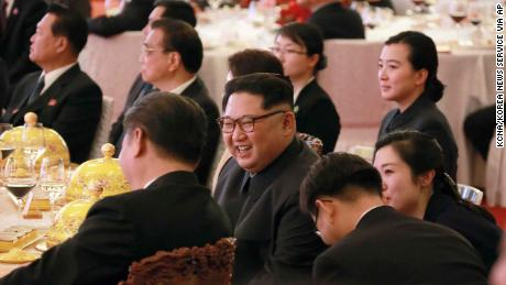 North Korean leader Kim Jong Un smiles as he and Chinese counterpart Xi Jinping attend a banquet at the Great Hall of the People in Beijing.