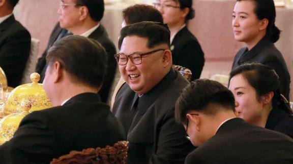 In this March 26, 2018, photo provided March 28, 2018 by the North Korean government, North Korean leader Kim Jong Un, center, smiles as he and Chinese counterpart Xi Jingping, center left, attend a banquet at the Great Hall of the People, in Beijing. North Korea