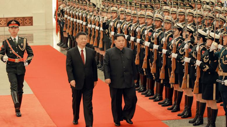 Chinese President Xi Jinping (left) and North Korean leader Kim Jong Un (right) are seen together in Beijing in a photograph released by North Korea's state-run Korean Central News Agency.