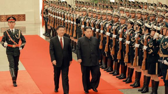 Chinese President Xi Jinping (left) and North Korean leader Kim Jong Un (right) are seen together in Beijing in a photograph released by North Korea's state-run Korean Central News Agency