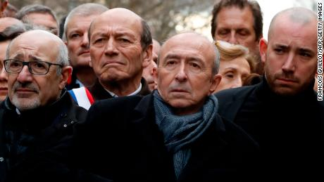 French Interior Minister Gerard Collomb, second right, and other French officials marching in Paris on Wednesday,