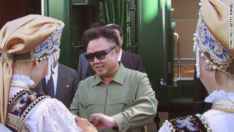 Late North Korean leader Kim Jong Il is greeted by women in traditional costume as he arrives August 1, 2001 at the train station in the Siberian city of Omsk, Russia for the first stopover on his train journey to Moscow. Kim met Russian President Vladimir Putin on August 4.