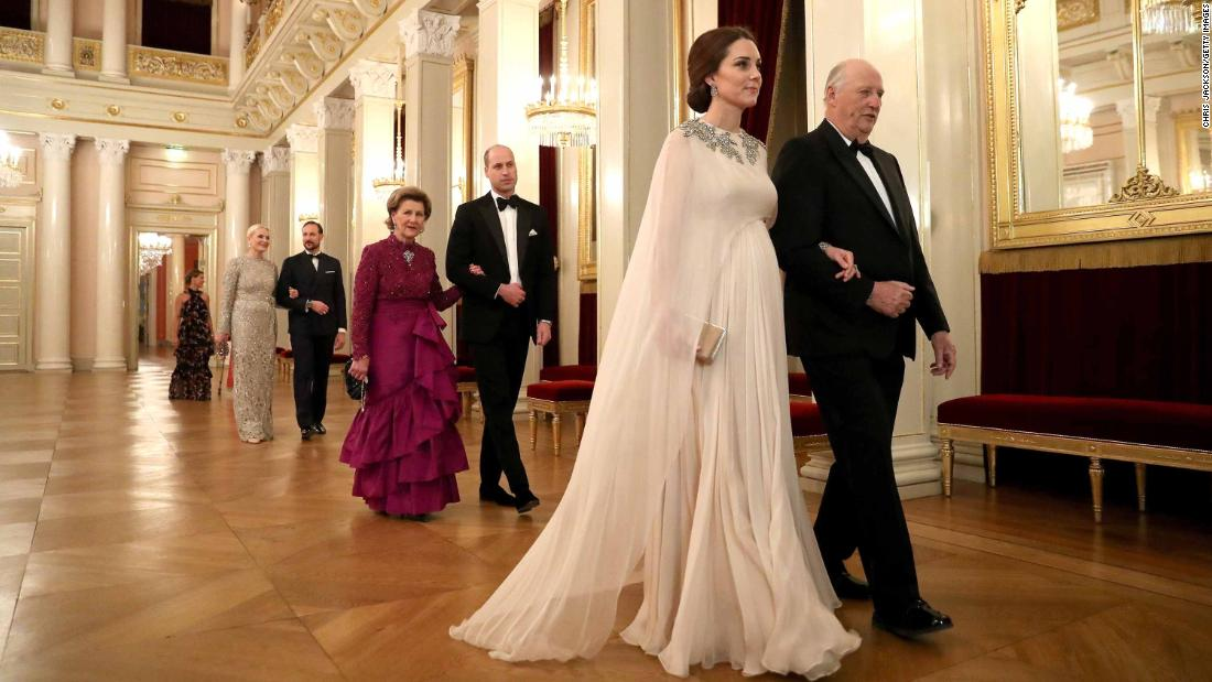 Catherine is escorted to dinner by King Harald V of Norway and Prince William is escorted by Queen Sonja of Norway at the Royal Palace in Oslo on February 1 during their visit to Norway.