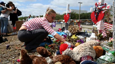 Volunteers sorted through teddy bears, flowers and hand-written letters honoring the 17 victims.