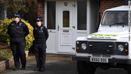 Police officers stand outside former Russian spy Sergei Skripal's home.