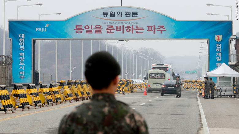 South Korean soldiers stand as vehicles carrying a South Korean delegation pass the Unification Bridge, which leads to Panmunjom in the Demilitarized Zone, South Korea, Thursday, March 29.