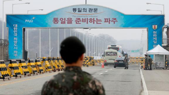 South Korean soldiers stand as vehicles carrying a South Korean delegation pass the Unification Bridge, which leads to the Panmunjom in the Demilitarized Zone, South Korea, Thursday, March 29.