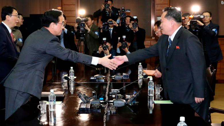 South Korean Unification Minister Cho Myoung-gyon, left, shakes hands with North Korean delegation head Ri Son Gwon at Panmunjom on March 29.