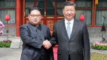 President Xi Jinping shakes hands with North Korean leader Kim Jong Un in Beijing in 2018. (AFP/Getty Images/KCNA VIA KNS)