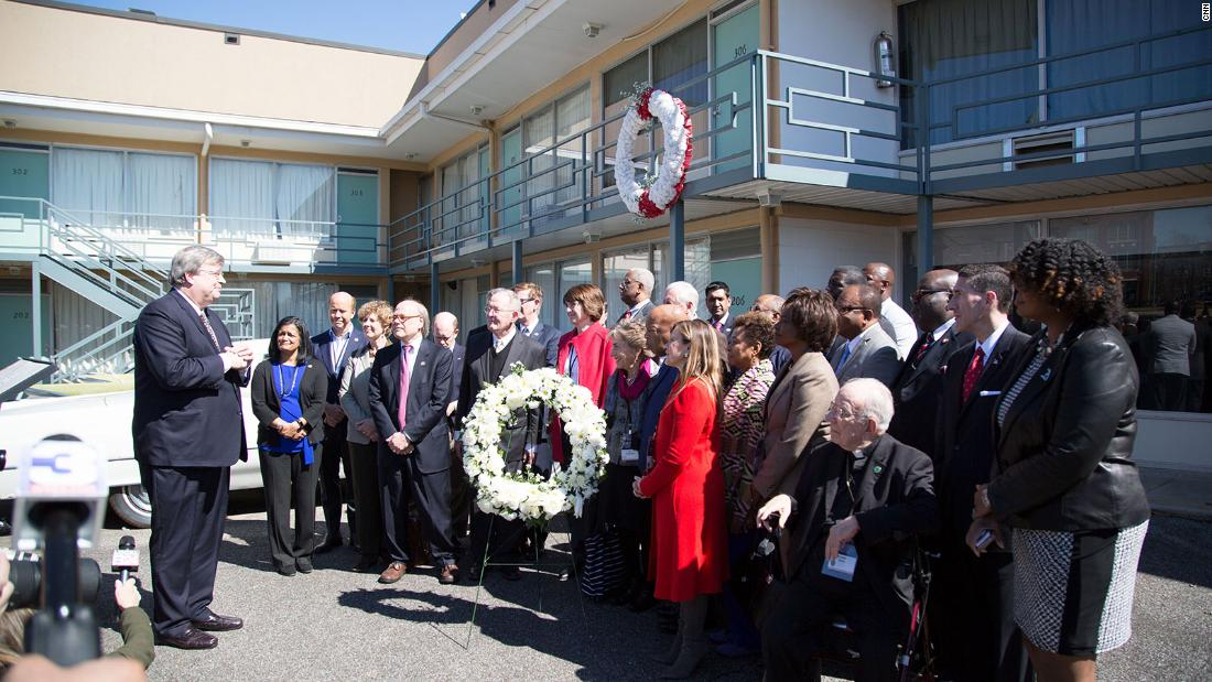 Bipartisan members of Congress stand together at the Lorraine Motel to honor King.