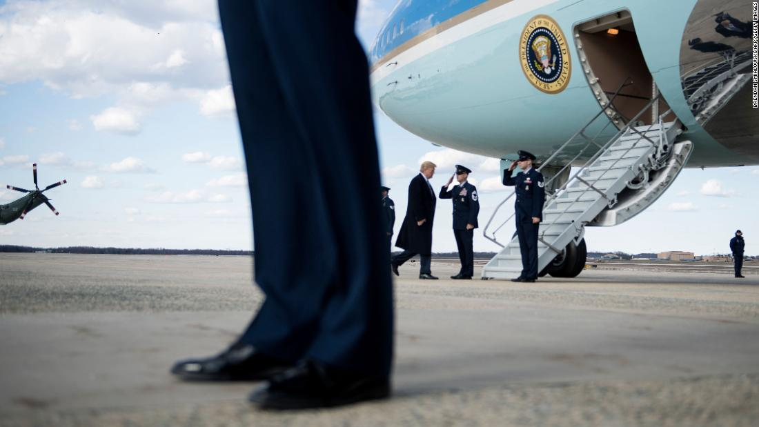 US President Donald Trump boards Air Force One before heading to his Mar-a-Lago resort in Florida on Friday, March 23.