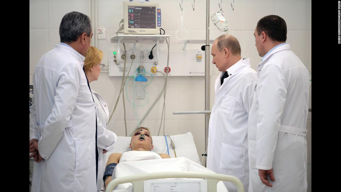 "Russian President Vladimir Putin, second from right, visits a person who was injured in <a href=""https://www.cnn.com/2018/03/27/europe/russia-kemerovo-shopping-mall-fire-intl/index.html"" target=""_blank"">a shopping-mall fire</a> on Sunday, March 25. Authorities said 64 people died in the blaze, which happened in the Siberian city of Kemerovo. Putin blamed the fire on ""criminal negligence"" and promised that those responsible would be held accountable."