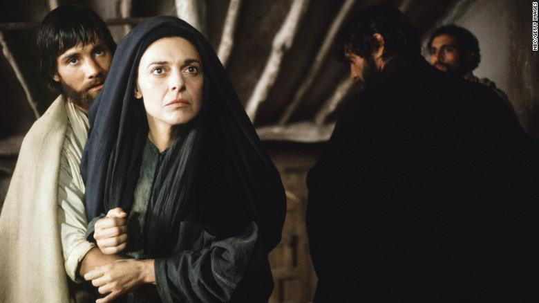 """Mary Magdalene, as played by Anne Bancroft in the film """"Jesus of Nazareth,"""" announces the resurrection to the skeptical disciples."""