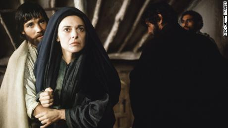 "Mary Magdalene, as played by Anne Bancroft in the film ""Jesus of Nazareth,"" announces the resurrection to the skeptical disciples."