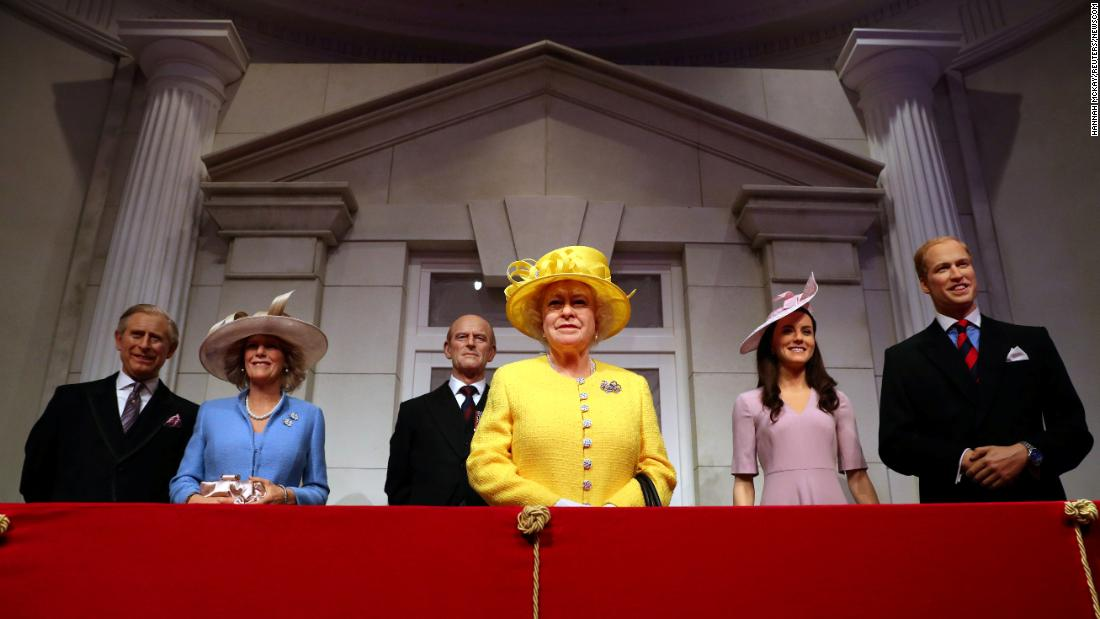 Wax figures of the British royal family are unveiled at the Madame Tussauds museum in London on Monday, March 26. It's part of the museum's new royal balcony experience.