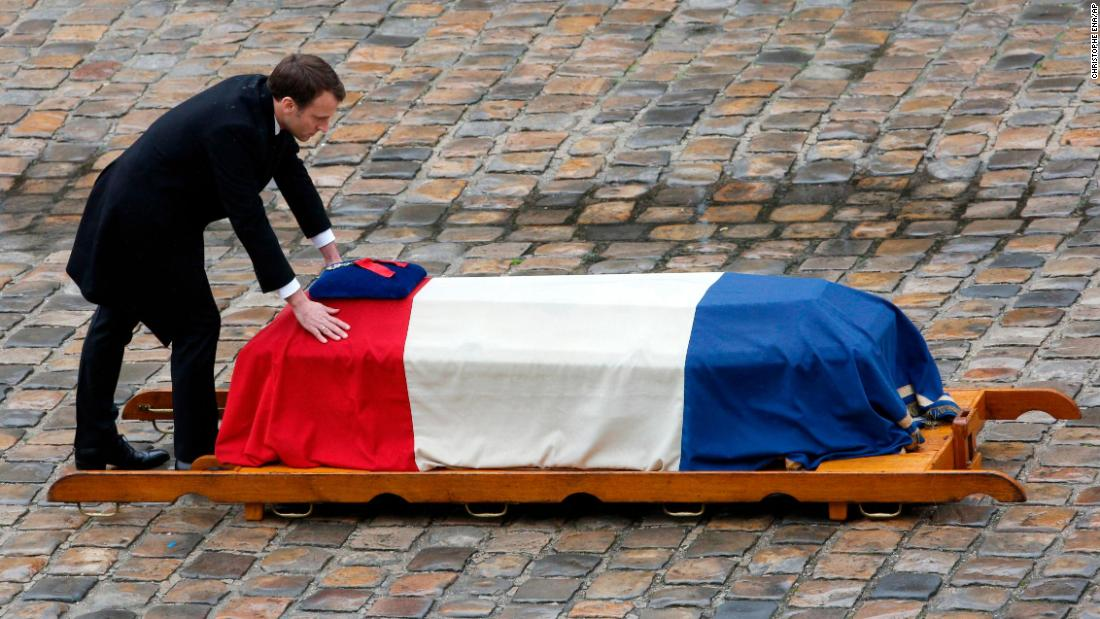 "French President Emmanuel Macron leans on the coffin of Lt. Col. Arnaud Beltrame after <a href=""https://www.cnn.com/2018/03/28/europe/france-funeral-officer-arnaud-beltrame-intl/index.html"" target=""_blank"">Beltrame was posthumously awarded the Legion of Honor</a> on Wednesday, March 28. Beltrame, a 45-year-old military police officer, was killed in southern France on March 23. He had offered to take the place of a female hostage during a terror attack on a supermarket."