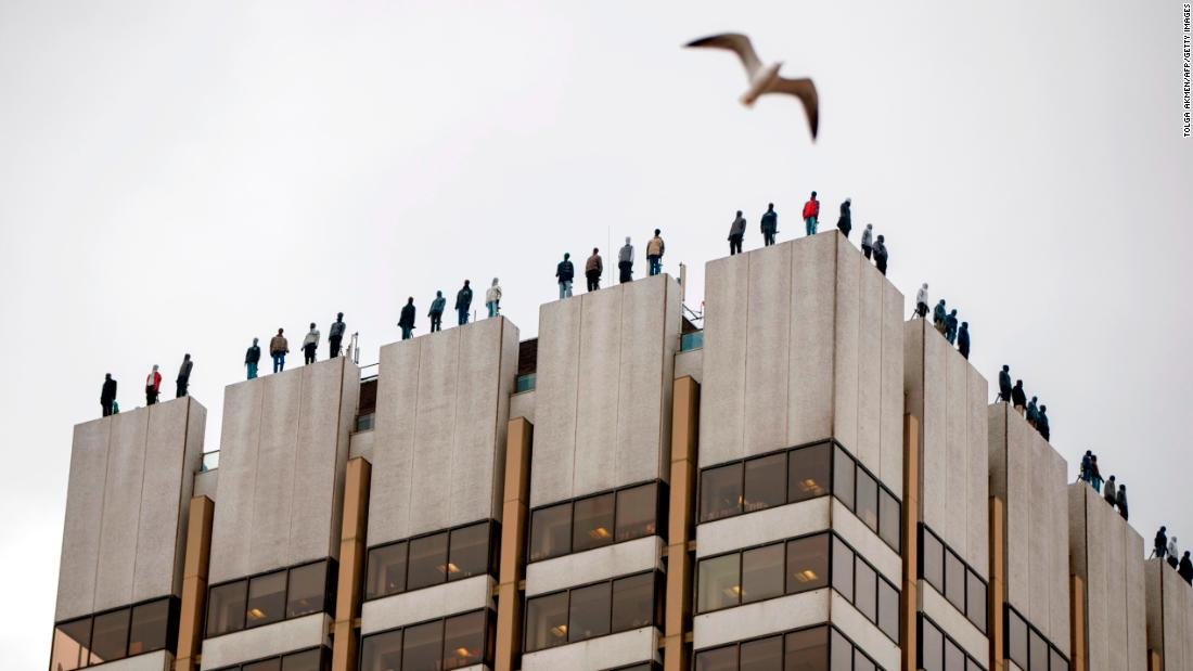 "Life-sized sculptures of 84 men are positioned on the roof of a television building in London on Tuesday, March 27. It was part of ""Project 84,"" a group's campaign to start a conversation about male suicide. The 84 sculptures represent the number of men who take their own lives every week in the United Kingdom. <a href=""http://www.cnn.com/2018/03/23/world/gallery/week-in-photos-0323/index.html"" target=""_blank"">See last week in 30 photos</a>"