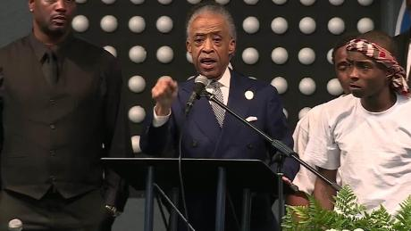 Rev. Al Sharpton speaks at the funeral of Stephon Clark while standing next to his brother Stevante Clark.