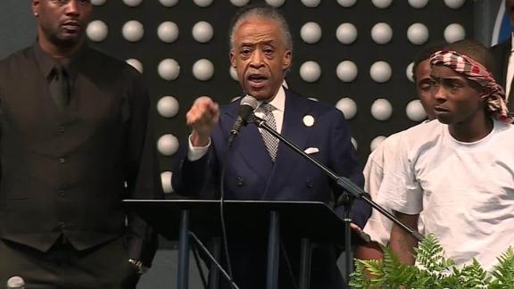 The Rev. Al Sharpton speaks at the funeral for Stephon Clark while standing next to his brother, Stevante Clark.