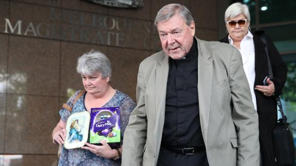 Cardinal George Pell leaves the court after his hearing at the Melbourne Magistrates Court in Melbourne on March 29.