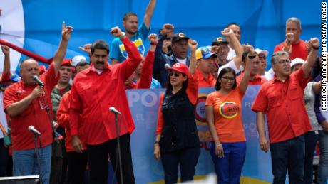 "(L-R) Venezuelan deputy Diosdado Cabello, President Nicolas Maduro, First Lady Cilia Flores, former Minister of Foreign Affairs Delcy Rodriguez and Education Minister Elias Jaua gesture during the closing of the campaign to elect members for the Constituent Assembly that would rewrite the constitution, in Caracas on July 27, 2017 on the second day of a 48-hour general strike called by the opposition. Venezuela's opposition called for a nationwide protest on Friday in outright defiance of a new government ban on demonstrations ahead of a controversial weekend election. ""The regime declared we can't demonstrate... We will respond with the TAKING OF VENEZUELA tomorrow,"" the opposition coalition, the Democratic Unity Roundtable, said Thursday on its Twitter account.  / AFP PHOTO / Federico PARRA        (Photo credit should read FEDERICO PARRA/AFP/Getty Images)"