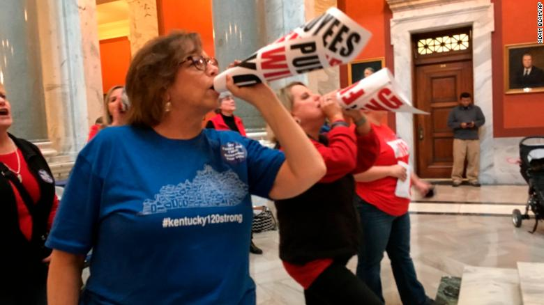 "Retired teacher Lydia Coffey chants ""Vote them out"" as lawmakers in Kentucky debate a bill to make changes to the state's pension system."