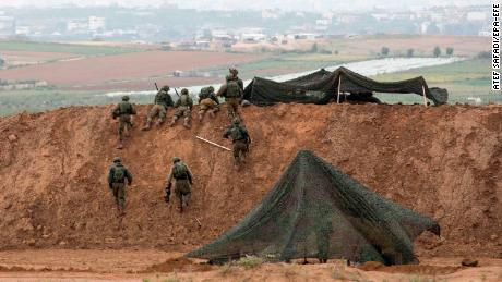 Israeli soldiers occupy positions at the border.