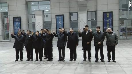 Chinese officials wave goodbye as Kim's train departs Dandong.