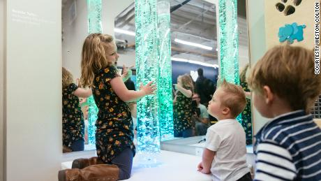 Children play with bubble tubes in the new sensory room.