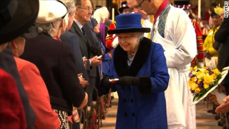 BRITAIN-ROYALS/QUEEN   VIDEO SHOWS: QUEEN ELIZABETH ATTENDING A MAUNDY THURSDAY SERVICE AT WINDSOR CASTLE, QUEEN ELIZABETH HANDING OUT COMMEMORATIVE COINS, QUEEN ELIZABETH TALKING TO PEOPLE AT THE SERVICE, PEOPLE SINGING, QUEEN ELIZABETH MEETING CHILDREN AND POSING FOR A PHOTOGRAPH WITH THEM AND YEOMEN WARDERS ALSO KNOWN AS BEEFEATERS