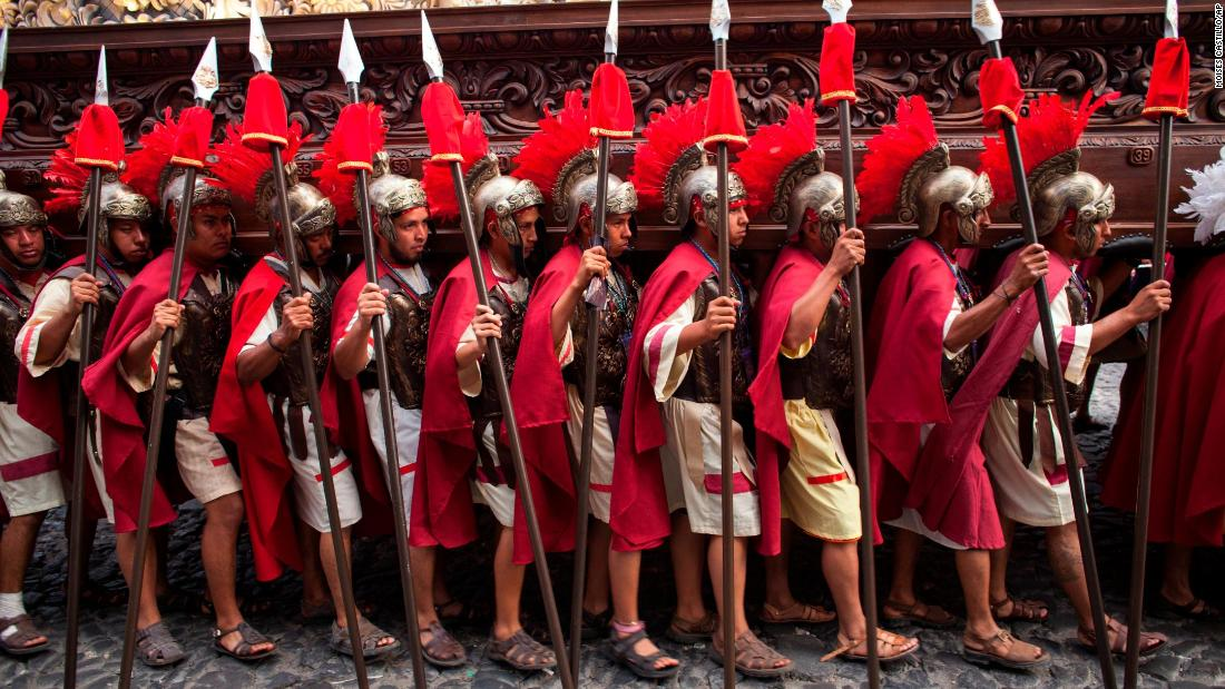 Men dressed as Roman soldiers carry a float featuring a statue of Jesus during a Holy Week procession by members of San Francisco church in Antigua, Guatemala, on March 29. For days leading up to Easter Sunday each year, processions and religious floats parade through the streets of villages and cities across the country.