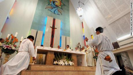 Taiwanese Catholic priests pray for the late Pope John Paul II during a service in Taipei, April 3, 2005.