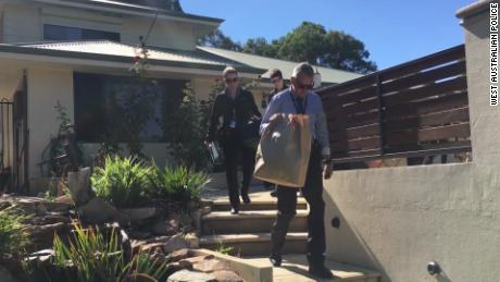 Australian police raid a house in Western Australia in March 2018 during an investigation into child sex abuses.