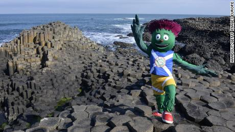 COUNTY ANTRIM, NORTHERN IRELAND - MAY 21:  (EDITORIAL USE ONLY, NO SALES)  In this handout image provided by Glasgow 2014 Ltd, Clyde, the 2014 Commonwealth Games mascot, poses at the Giants Causeway during the Glasgow 2014 Baton Relay on May 21, 2014 in County Antrim, Northern Ireland. Northern Ireland is nation 67 of 70 nations and territories the Queen's Baton will visit.  (Photo by Ben Birchall/Glasgow 2014 Ltd via Getty Images)
