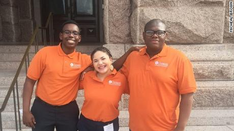 Micheal, far right, stands with friends Eric Muthondu and Sammantha Garcia during the Subiendo Academy at University of Texas Austin. All three are first-generation college students that have been accepted to Harvard.