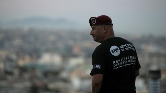 """TIJUANA, MEXICO - JULY 03:  U.S. Army veteran Hector Barajas looks out over the city on July 3, 2017 in Tijuana, Mexico. The Deported Veterans Support House, also known as """"The Bunker"""" was founded by deported U.S. Army veteran Hector Barajas to support deported veterans by offering food, shelter, clothing as well as advocating for political legislation that would prohibit future deportations of veterans. There are an estimated 11,000 non-citizens serving in the U.S. military and most will be naturalized during or following their service. Those who leave the military early or who are convicted of a crime after serving can be deported.  (Photo by Justin Sullivan/Getty Images)"""