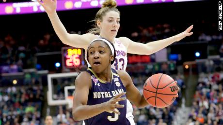Notre Dame's Jackie Young, front, heads to the basket during the second half in the semifinals of the women's NCAA Final Four college basketball tournament.